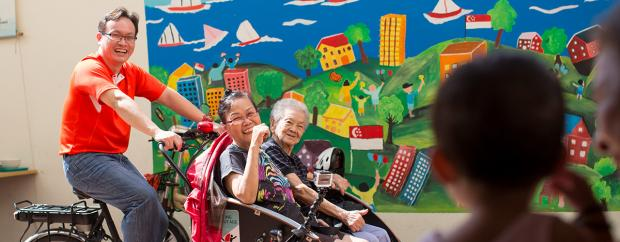 A volunteer from Cycling Without Age taking his local elders out for a ride